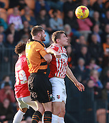 Barnet defender Michael Nelson & Exeter City midfielder David Wheeler compete for a high ball during the Sky Bet League 2 match between Barnet and Exeter City at The Hive Stadium, London, England on 31 October 2015. Photo by Bennett Dean.