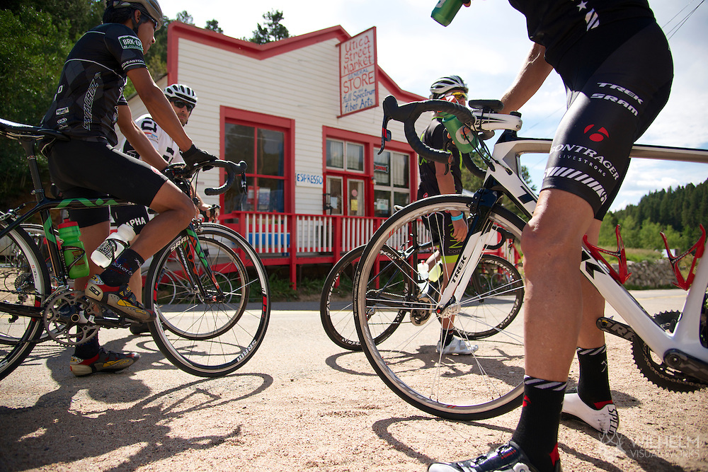 08 September 2013: Riders enjoy a breather at the Utica Street Market in Ward at the top of the climb during the bicycle ride from the front range city of Boulder to the mountain town of Ward via Old Stage Road and Left Hand Canyon in Boulder, CO. ©Brett Wilhelm/Clarkson Creative - RAW Files Available On Request