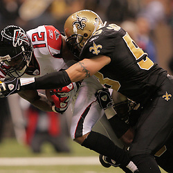 2008 December, 07: Atlanta Falcons wide receiver Michael Jenkins (12) is tackled by New Orleans Saints linebacker Scott Shanle (58) after a reception during the first half of a game between NFC South divisional rivals the Atlanta Falcons and the New Orleans Saints at the Louisiana Superdome in New Orleans, LA.