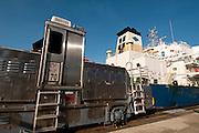 Cargo ship and locomotive at Miraflores Locks. Panama Canal, Panama City, Panama, Central America.