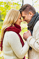 Portrait of mature couple making a vow in park