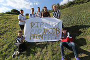 Fans with a tribute banner to Matt Grimstone and Jacob Schilt during the FA Vase 1st Qualifying Round match between Worthing United and East Preston FC at the Robert Eaton Memorial Ground, Worthing, United Kingdom on 6 September 2015. The first home match for Worthing United since losing team mates Matthew Grimstone and Jacob Schilt in the Shoreham air show disaster.