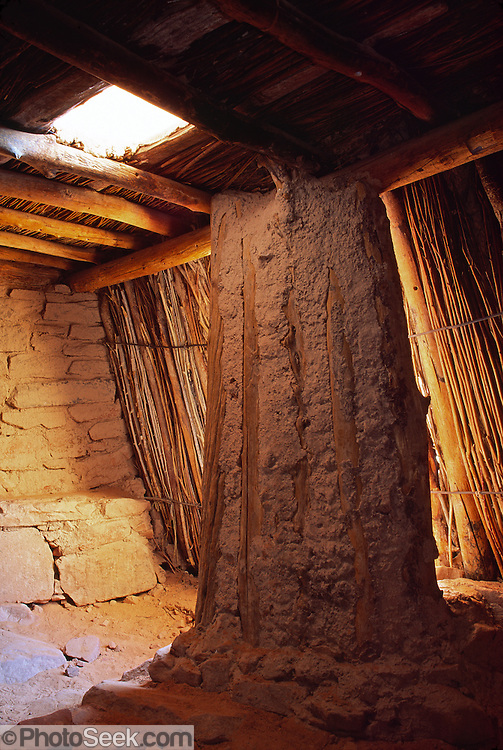A kiva (ceremonial room) has been restored at Three Roof Ruin, on Escalante River Arm of Lake Powell, in Glen Canyon National Recreation Area, Utah, USA. A wall has been breached to allow visitors to enter, but traditionally, the sunken round kivas were entered from the hole in the roof.