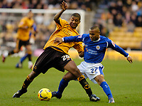 Photo: Leigh Quinnell.<br /> Wolverhampton Wanderers v Leicester City. Coca Cola Championship. 09/12/2006. Wolves' Mark Little, battles with Leicesters Levi Porter.