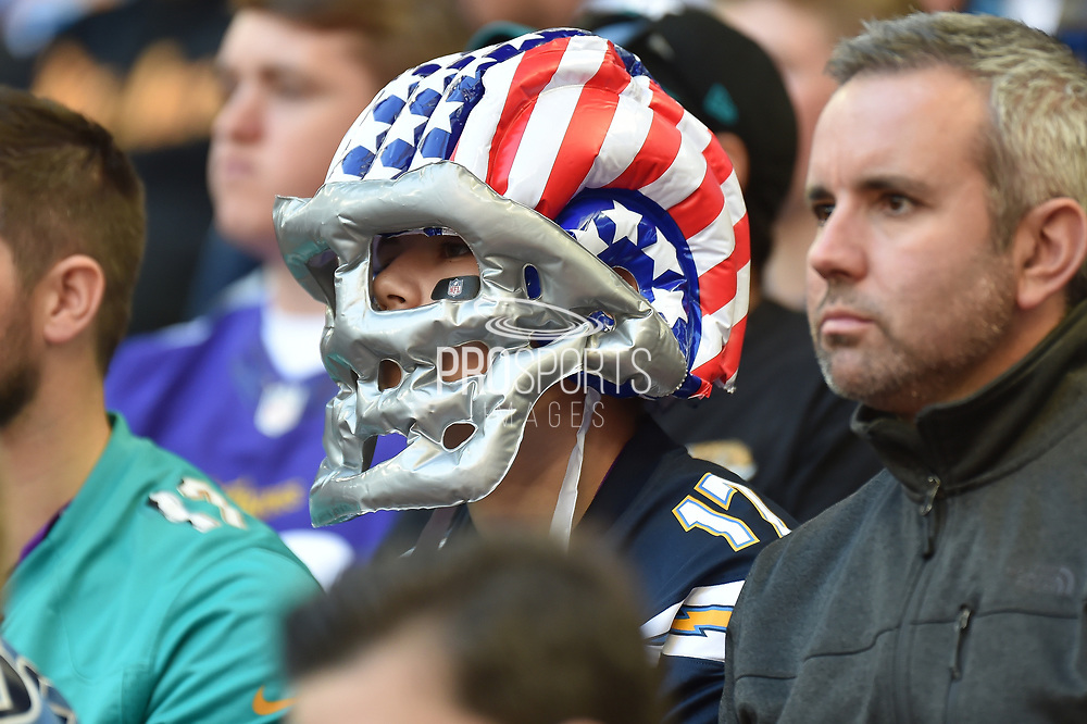 A fan wearing an inflatable Stars and Stripes Football helmet during the International Series match between Tennessee Titans and Los Angeles Chargers at Wembley Stadium, London, England on 21 October 2018.