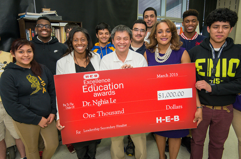 Dr. Nghia Le, center, poses for a photograph with principal LaShinda Bilbo-Ervin, left, Rhonda Skillern-Jones, right, some of his students after being recognized as a finalist in the 2015 HEB Excellence in Education Awards at Washington High School, March 12, 2015.
