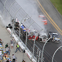 A horrific wreck of NASCAR driver Kyle Larson occurs with debris flying into the spectator grandstand area on the front stretch during a NASCAR Drive for COPD 300 race at Daytona International Speedway on Saturday, February 23, 2013 in Daytona Beach, Florida.  (Photo/Alex Menendez)