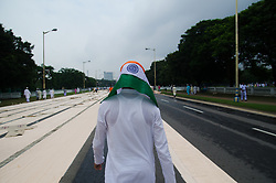 September 2, 2017 - Kolkata, West Bengal, India - A Indian Muslim man wrapped his head with Indian national flag has seen at the end of Eid al-Adha prayer at Red Road on 2nd September 2017, in Kolkata, West Bengal, India. (Credit Image: © Avijit Ghosh/Pacific Press via ZUMA Wire)