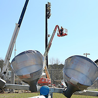 Adam Robison | BUY AT PHOTOS.DJOURNAL.COM<br /> A worker with The Service Company TSC, rides a lift to help remove a set of the old lights at Eastwood Park Tuesday morning in Tupelo.