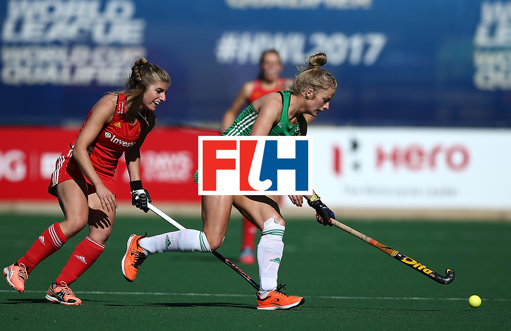 JOHANNESBURG, SOUTH AFRICA - JULY 16:  Hannah Matthews of Ireland controls the ball from Sarah Haycroft of England during day 5 of the FIH Hockey World League Women's Semi Finals Pool A match between England and Ireland at Wits University on July 16, 2017 in Johannesburg, South Africa.  (Photo by Jan Kruger/Getty Images for FIH)