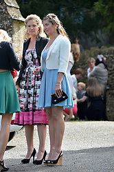 Left to right, sisters of the bride PRINCESS BEATRICE VON PREUSSEN and PRINCESS AUGUSTA VON PREUSSEN at the wedding of Princess Florence von Preussen second daughter of Prince Nicholas von Preussen to the Hon.James Tollemache youngest son of the 5th Lord Tollemache held at the Church of St.Michael & All Angels, East Coker, Somerset on 10th May 2014.