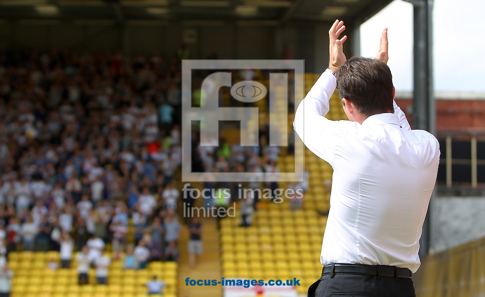 Dougie Freedman, manager of Bolton Wanderers applauds the travelling support before the Sky Bet Championship match at Vicarage Road, Watford<br /> Picture by John Rainford/Focus Images Ltd +44 7506 538356<br /> 09/08/2014