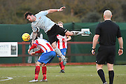 Lewes FC Stacy Freeman heads the ball from Dorking Wanderers Matt Briggs during the Ryman League - Div One South match between Dorking Wanderers and Lewes FC at Westhumble Playing Fields, Dorking, United Kingdom on 28 January 2017. Photo by Jon Bromley.
