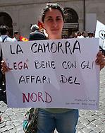 Roma 28 Giugno 2011.Manifestazione per l'emergenza spazzatura a Napoli davanti a Montecitorio.Cartello contro la Lega Nord