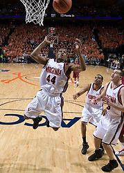 Virginia Cavaliers point guard Sean Singletary (44) goes up for a rebound in action against FSU.  The Virginia Cavaliers Men's Basketball Team defeated the Florida State Seminoles 73-70 at the John Paul Jones Arena in Charlottesville, VA on February 17, 2007.