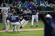 Brandon Barnes of The Colorado Rockies meets his teammates at home plate after scoring a walkoff homerun to win against the San Francisco Giants at Coors Field in Denver, Colorado on June 7, 2014.