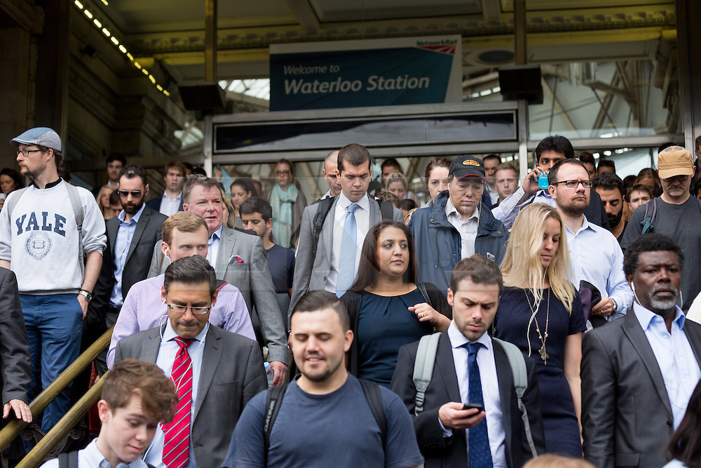 © Licensed to London News Pictures. 06/08/2015. London, UK. Crowds of commuters walk from Waterloo station in London. A tube strike today has closed the TfL London Underground network as members of four unions take industrial action for the second time in a month because of a deadlocked dispute over plans to launch a new all-night tube train service next month. Extra busses have been laid on to help commuters get to work. Photo credit : Vickie Flores/LNP