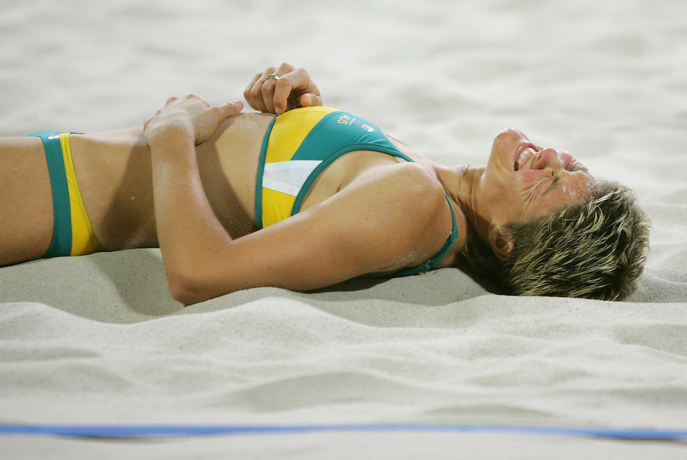 Australia's Natalie Cook grimaced in pain after reinjuring her shoulder during the women's beach volleyball bronze medal match at the 2004 Summer Olympic Games in Athens, Greece. Cook served underhand in the third set due to the injury. Australia lost the match in three sets to the United States for the bronze.