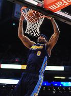 Mar. 10, 2011; Phoenix, AZ, USA; Denver Nuggets forward Gary Forbes (0) dunks the ball against the Phoenix Suns at the US Airways Center. Mandatory Credit: Jennifer Stewart-US PRESSWIRE
