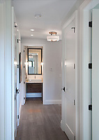 A new home is an upscale cottage, featuring greyed white oak flooring, white cabinetry and rustic wood elements. SC Smith Building Company, Victoria, BC
