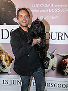 2019, June 12. UPI, Amsterdam, the Netherlands. Bas Smit and his dog Lucky at the dutch premiere of A Dog's Journey.