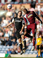 Photo: Jed Wee.<br />Burnley v Hull. Coca Cola Championship. 14/10/2006.<br /><br />Hull's Ian Ashbee (L) jumps with Burnley's Gifton Noel-Williams.