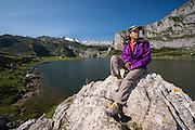 Trekker, Ercina lake and mountain range, Picos de Europa National Park, Asturias, Spain