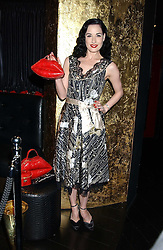 DITA VON TEESE at a preview of Lulu Guinness's new Handbag Collection ' Couture' held at Aviva, Baglioni Hotel, 60 Hyde Park Gate, London SW7 on 15th February 2006.<br />