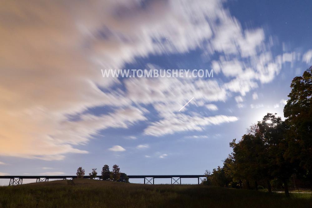 Salisbury Mills - The full moon rises by the Moodna Viaduct railroad trestle on Oct. 8, 2014.