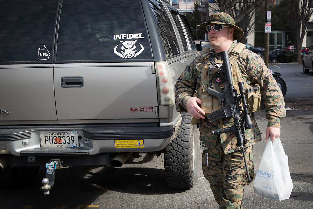 The Georgia Security Force III% militia holds a protest on Marietta Street in downtown Atlanta on Saturday, Feb. 6, 2016. The protest was partly inspired by the death of LaVoy Finicum by federal authorities. Here, Chris Hill prepares to head to the protest. About a half-dozen people showed up. Photo by Kevin D. Liles/kevindliles.com