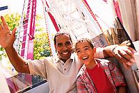Seattle, Washington, USA --- Father and Son Riding Ferris Wheel --- Image by © Jim Cummins/CORBIS