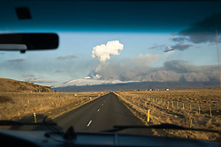 View from a car heading towards fhe cloud of ash from the Eyjafjallajoekull erupting volcano in Iceland. .©2010 Michael Schofield. All Rights Reserved.