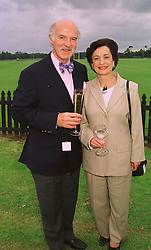 MR & MRS ANTON MOSIMANN he is the leading chef, at a polo match in Berkshire on 14th June 1998.MII 21