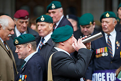 © Licensed to London News Pictures. 24/03/2017. London, UK. Former members of armed forces drink as they wait Sergeant Alexander Blackman's sentencing outside the Royal Courts of Justice in London. The decision is delayed until next Tuesday. Also known as Marine A, Sgt Blackman's life sentence was reduced to manslaughter for killing a wounded Taliban fighter in Afghanistan in 2011. Photo credit: Tolga Akmen/LNP