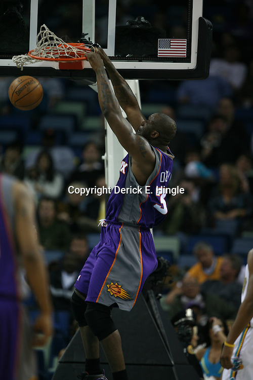 Shaquille O'Neal #32 dunks for the Phoenix Suns on February 26, 2008 at the New Orleans Arena in New Orleans, Louisiana. The New Orleans Hornets defeated the Phoenix Suns 120-103.