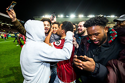 Korey Smith of Bristol City is surrounded by fans on the pitch at full time after he scores a goal in the 93rd minute to make it 2-1 and win the match for his side - Rogan/JMP - 20/12/2017 - Ashton Gate Stadium - Bristol, England - Bristol City v Manchester United - Carabao Cup Quarter Final.