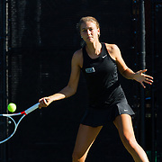 10 November 2017:  The San Diego State Aztecs women's tennis team hosts it's annual Fall Classic II. Jana Both of San Diego State returns a serve during a doubles match friday morning.<br /> www.sdsuaztecphotos.com
