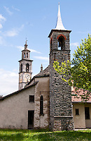 Ticino, Southern Switzerland. Intragna. Two church towers - one ancient stone and the other Italianate.