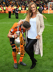 Free to use courtesy of Sky Bet - Barry Douglas of Wolverhampton Wanderers and partner celebrate after lifting the Sky Bet Championship 2017/18 league trophy - Mandatory by-line: Matt McNulty/JMP - 28/04/2018 - FOOTBALL - Molineux - Wolverhampton, England - Wolverhampton Wanderers v Sheffield Wednesday - Sky Bet Championship