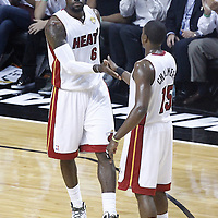 21 June 2012: Miami Heat small forward LeBron James (6) is congratulated by Miami Heat point guard Mario Chalmers (15) during the Miami Heat 121-106 victory over the Oklahoma City Thunder, in Game 5 of the 2012 NBA Finals, at the AmericanAirlinesArena, Miami, Florida, USA. The Miami Heat wins the series 4-1.