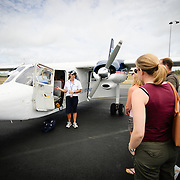 The pilot gives the safety briefing on the tarmac for passengers flying from Hervey Bay to Lady Elliot Island Resort.
