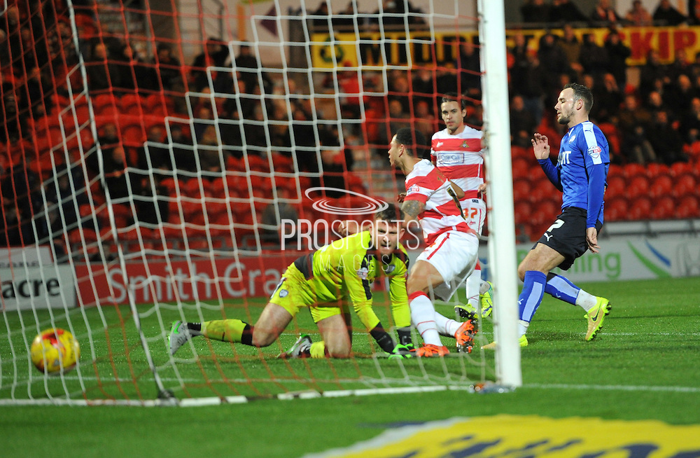 Nathan Tyson of Doncaster Rovers scores to go 1-0  during the Sky Bet League 1 match between Doncaster Rovers and Chesterfield at the Keepmoat Stadium, Doncaster, England on 24 November 2015. Photo by Ian Lyall.