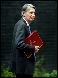 Secretary of State for Defence Philip  Hammond  leaves  No10 Downing Street after the Government's weekly Cabinet meeting, London, United Kingdom. Tuesday, 3rd September 2013. Picture by Andrew Parsons / i-Images
