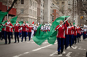 March 17, 2015 - New York, NY. Flag corps waves the green during New York City's annual St. Patrick's Day parade on 5th  Avenue. 04/17/2013 Photograph by Kevin R. Convey/NYCity Photo Wire