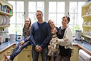 The Elliott family in their kitchen. From left to right: Molly Elliott (10), Richard Elliott, Milly-grace (8),  Tracey Elliott. Pickwell Manor, Georgeham, North Devon, UK.<br /> CREDIT: Vanessa Berberian for The Wall Street Journal<br /> HOUSESHARE
