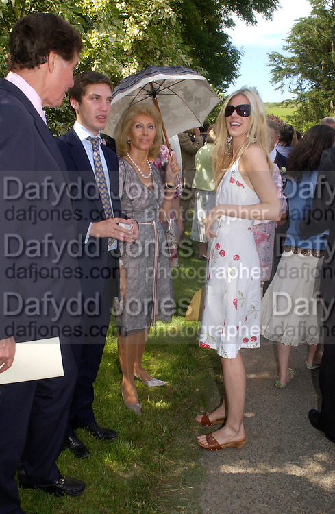 Alexandra Aitken. Marriage of Emilia Fox to Jared Harris. St. Michael's and All Angels. Steeple. Nr. Wareham. Dorset. 16 July 2005. ONE TIME USE ONLY - DO NOT ARCHIVE  © Copyright Photograph by Dafydd Jones 66 Stockwell Park Rd. London SW9 0DA Tel 020 7733 0108 www.dafjones.com