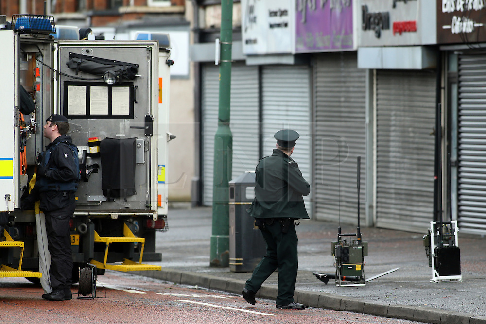 © Licensed to London News Pictures. 4/03/2016. Belfast, Northern Ireland, UK. PSNI (Police Service of Northern Ireland) Police officers stand beside British Army Bomb disposal teams, close to the scene of an early morning van bomb explosion in east Belfast. A 52 year old man, who is a serving prison officer, has since died it has been announced today. Photo credit : Paul McErlane/LNP