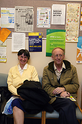 Couple at the waiting area of the Outpatients clinic,