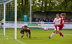 BANGOR, WALES - Thursday, May 8, 2014: Wales' Sarah Wiltshire scores the first goal after Montenegro's goalkeeper Marija Zizic fumbled the ball during the FIFA Women's World Cup Canada 2015 Qualifying Group 6 match at the Nantporth Stadium. (Pic by David Rawcliffe/Propaganda)