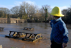 ©London News pictures... 17/11/2010. A group of children walk through the water. The River Fowey burst its banks at Lost Withiel in Cornwall. today (Wednesday). Some people have been left trapped in their cars and homes in parts of Cornwall as heavy rain and gale-force winds caused flooding and disruption.